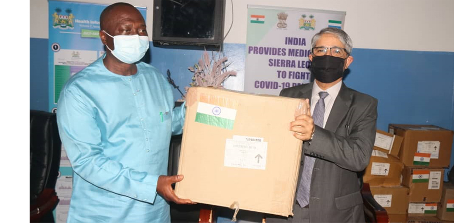 Handing over medicines to fight Covid-19 -- High Commissioner with Dy Health Minister Dr. Amara Jambai (5 Feb 2021)
